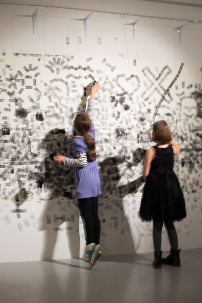 Two girls interacting with the installation.
